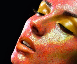 beautiful woman face with professional makeup, bright colors. cl
